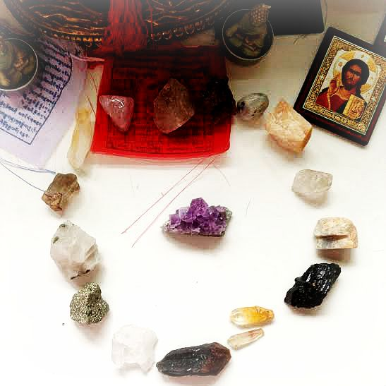 crystals being cleansed by unpolished, uncut amethyst, post-tingsha bells cleansing